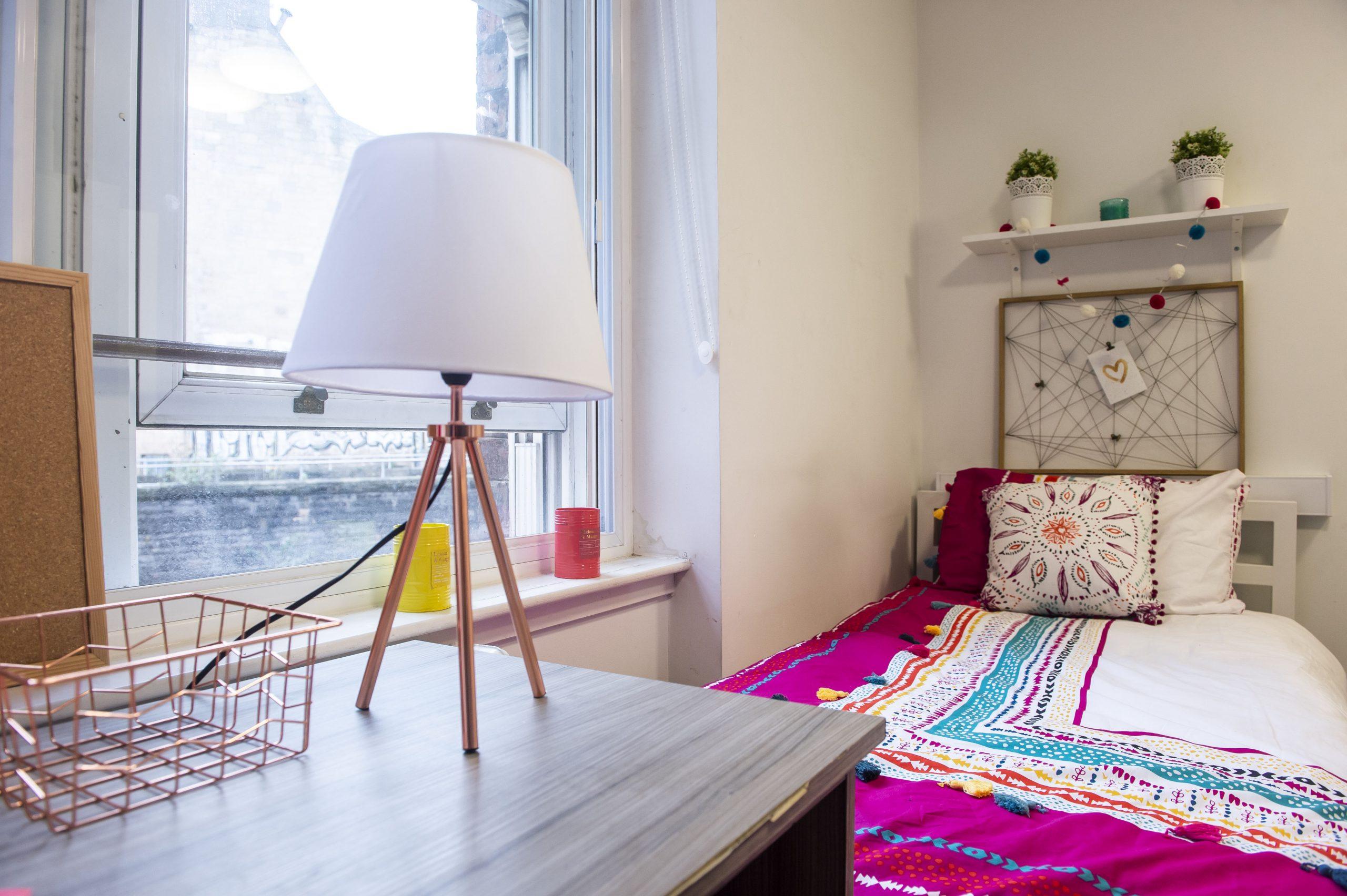 bed in student studio apartment