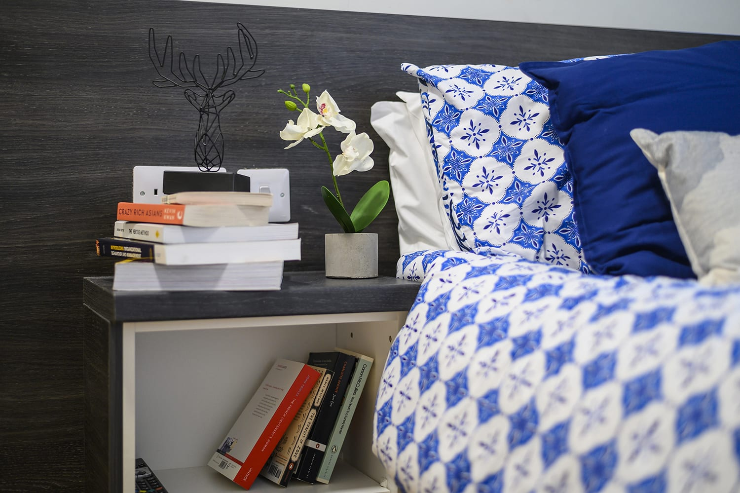 brightly coloured blue bedding on a student's bed