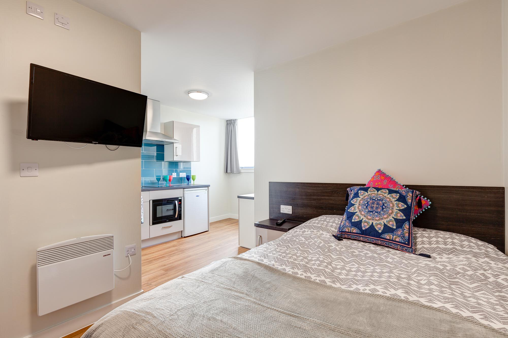 double bed with tv in Robert Owen House Glasgow