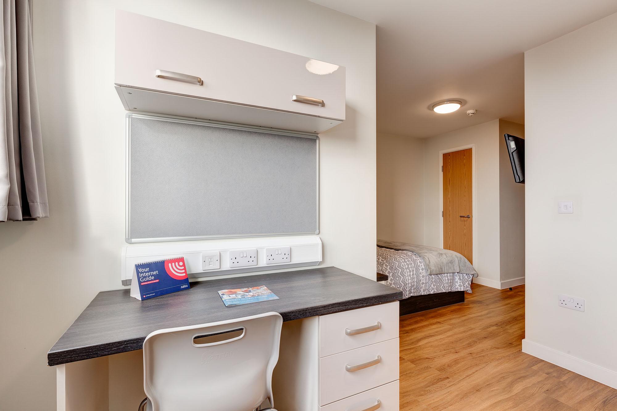 desk in student studio apartment