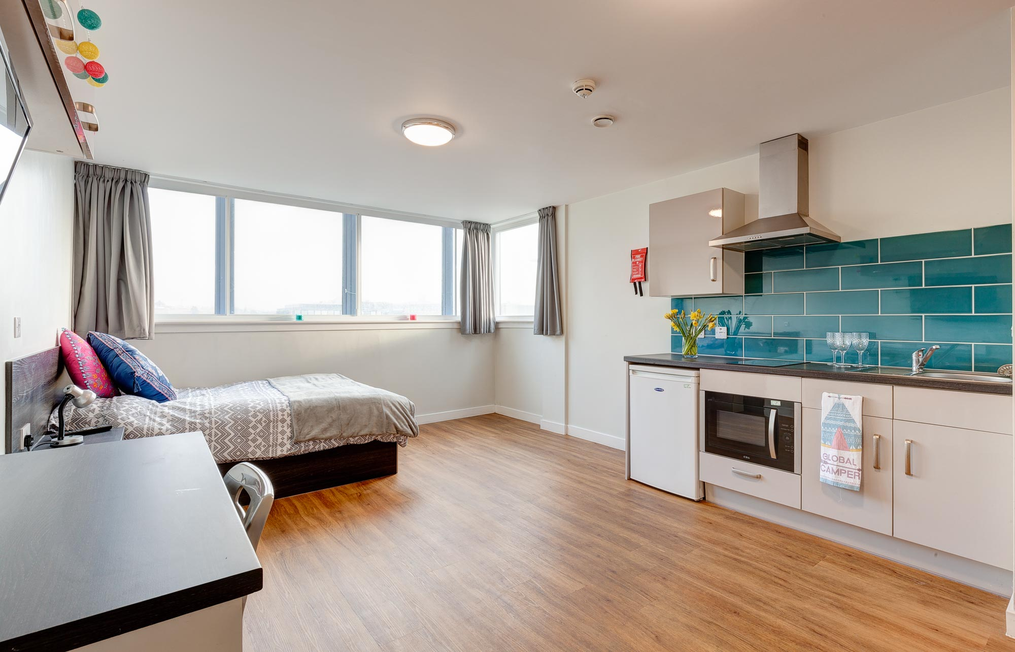 double bed and kitchen in Robert Owen House Glasgow