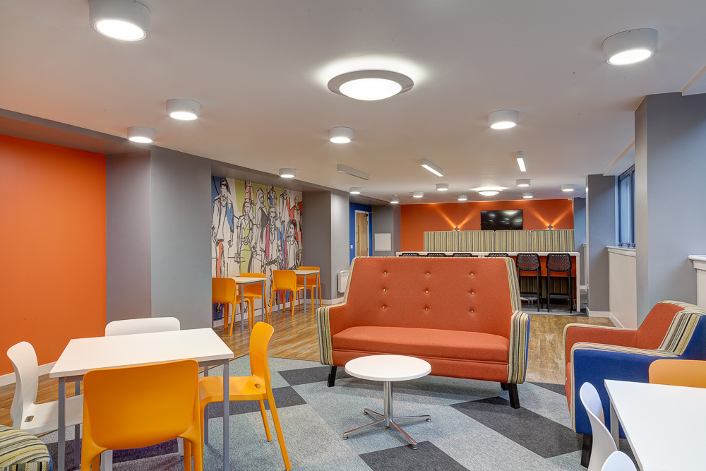 social area with tables and chairs in Robert Owen House Glasgow
